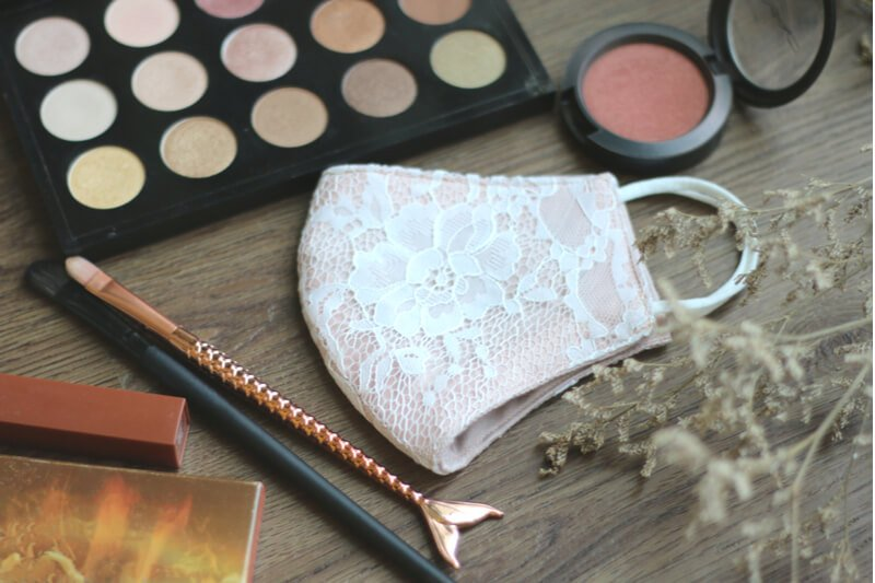 wearing makeup with facemask